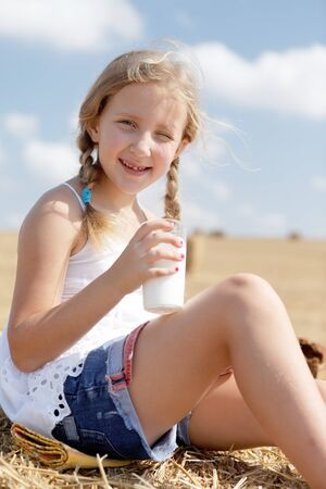 agri: happy girl eating healthy meal summer