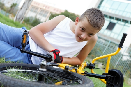 cute boy with his bicycle outside in the afternoon Stock Photo