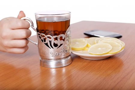 hot aromatic tea with lemons on the table photo
