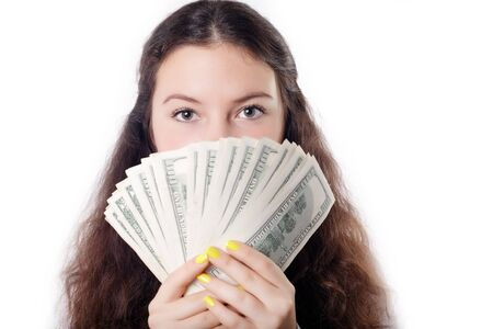 portrait of a teen brunette girl with money isolated photo