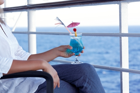 girl drinking a cocktail on a journey to the sea