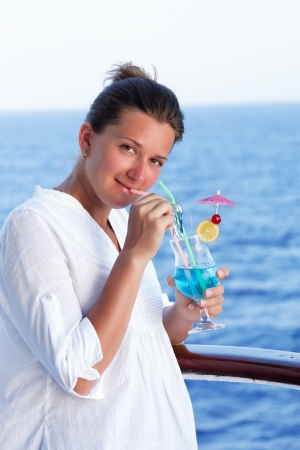 cute brunette girl enjoys traveling on a ship at sea Stock Photo