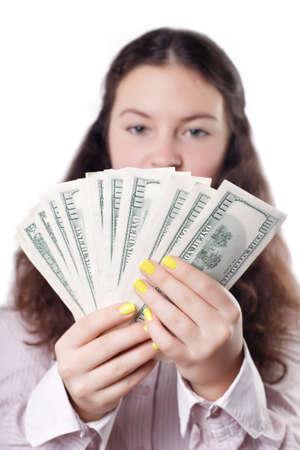 considers: cute brunette girl considers money isolated Stock Photo