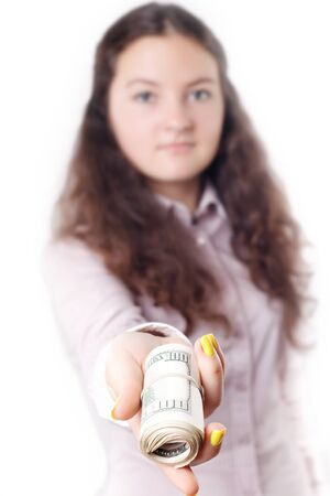 denominational: portrait of a girl giving money isolated on white background Stock Photo