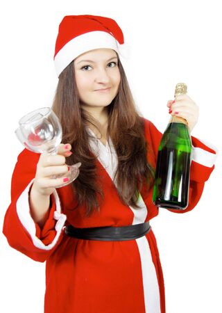 cute teen girl dressed as Santa with champagne isolated photo