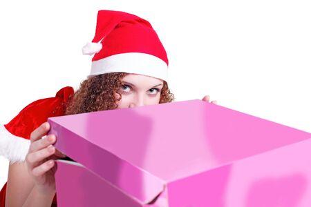 pretty curly girl looks like Santa gift isolated photo