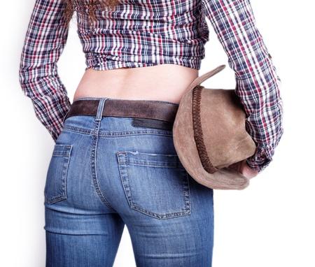 Cowboy girl posing backwards isolated white background Stock Photo