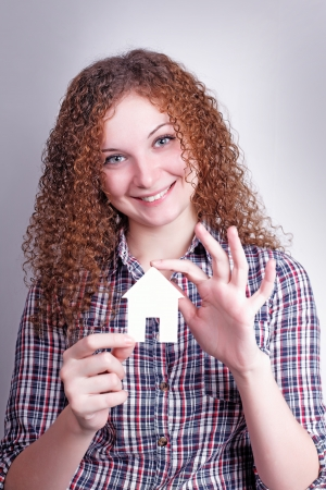 pretty curly girl builder with their dream house  photo
