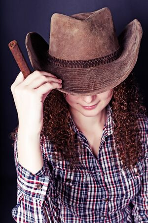 portrait of pretty curly red-haired girl with a cigar photo