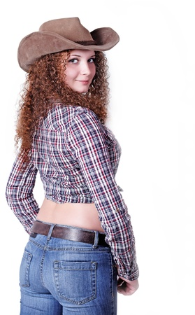 portrait of pretty curly red-haired girl on a light background photo