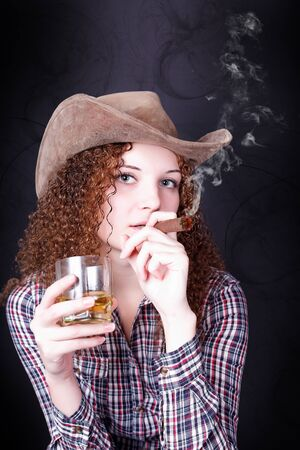 pretty girl smoking a cigar cowboy photo