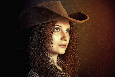 Art portrait of pretty curly girl cowboy photo