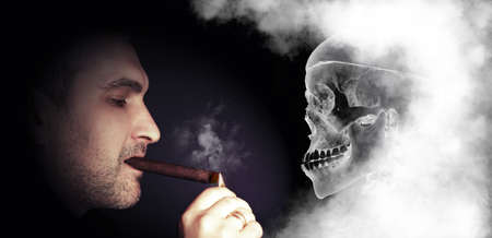 portrait of a man lights a skull on a dark background photo