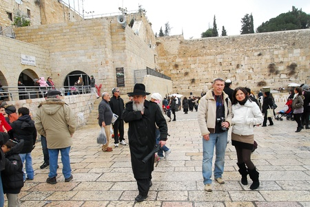 tourists at the ancient Wailing Wall Jerusalem