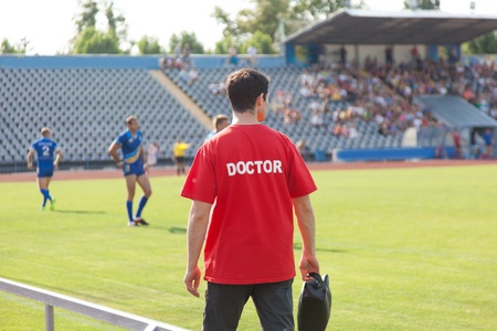 sports doctor, during the match, the players treat injuries Editorial