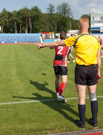 referee for the game of rugby, keeping an eye on the match photo