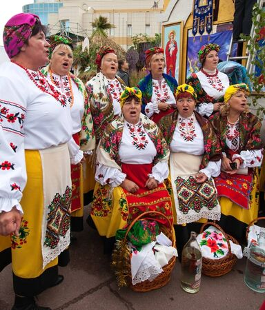 kharkov: people having fun singing, entertain people at the fair Editorial