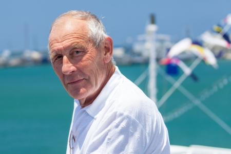 portrait of an elderly man resting on a cruise Stock Photo