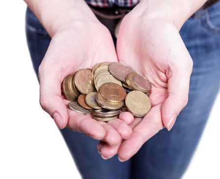 charity  symbol: accumulated a handful of coins in female hands Stock Photo