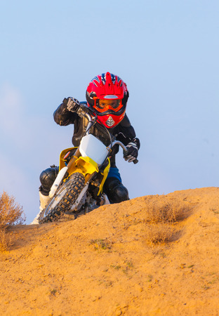 boy racer on a motorcycle in the desert, summer day Stock Photo