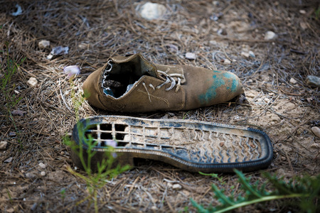 old torn shoes, trash wallow photo