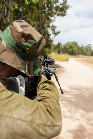 soldier aiming with a sniper rifle, military conflict photo