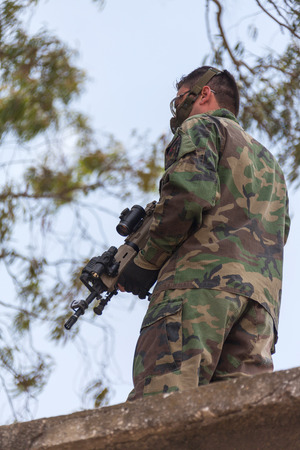 the occupant: armed man as a guard, a military order
