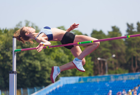 sportswoman jumps in height, sports background Stock Photo