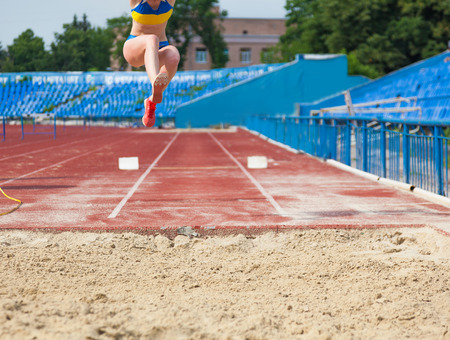 execution of the triple jump, sports background