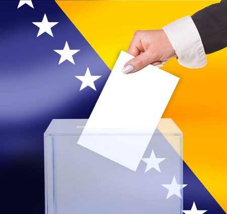electoral vote by ballot, under the Bosnia and Herzegovina flag photo