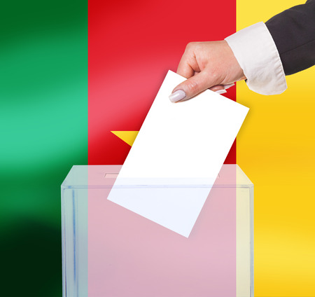 electoral vote by ballot, under the Cameroon flag photo
