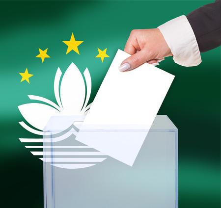 electoral: electoral vote by ballot, under the Macau flag