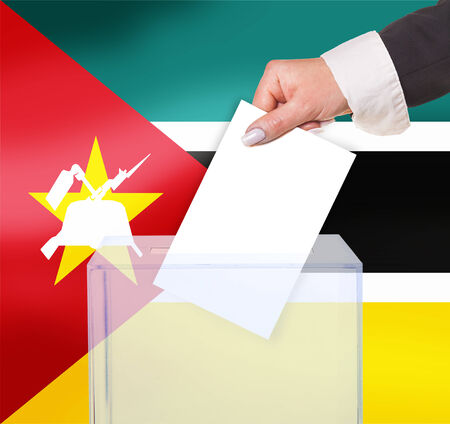 electoral: electoral vote by ballot, under the Mozambique flag Stock Photo