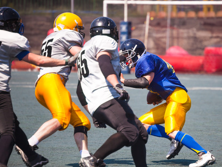opponents: athlete breaks through opponents play american  football