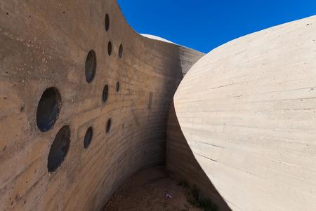 impasse: stone wall with round openings impasse labyrinth