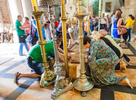 anointed: JERUSALEMISRAEL - 20 SEPTEMBER 2014: people bowed the stone anointed in the Holy Sepulchre. 20 september 2014 Jerusalem.