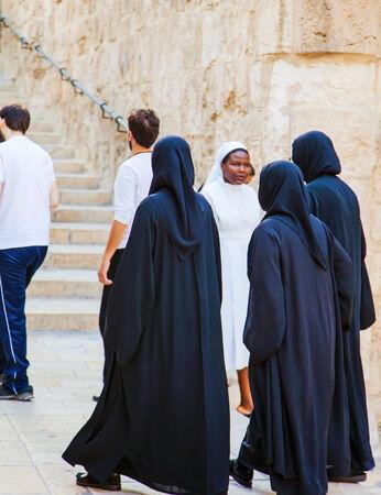 nuns: JERUSALEMISRAEL - 20 SEPTEMBER 2014: nuns walking down the street of Jerusalem. 20 september 2014 Jerusalem.