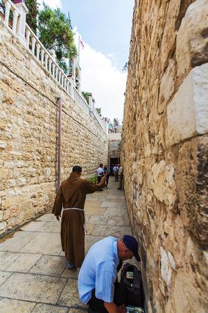 JERUSALEMISRAEL - 20 SEPTEMBER 2014:  monk walking down the street of Jerusalem. 20 september 2014 Jerusalem.
