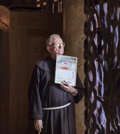 JERUSALEMISRAEL - 20 SEPTEMBER 2014: monk stands at the entrance with a sign in his hands. 20 september 2014 Jerusalem.