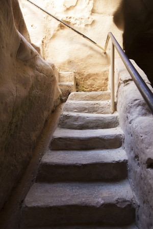 descent into the chalk cave with hewn stone steps photo