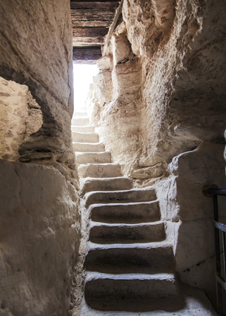 ancient stone stairs leading to the exit photo