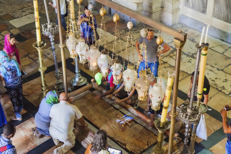 anointed: JERUSALEMISRAEL - 20 SEPTEMBER 2014: people sitting near stone anointed in the Holy Sepulchre. 20 september 2014 Jerusalem. Editorial