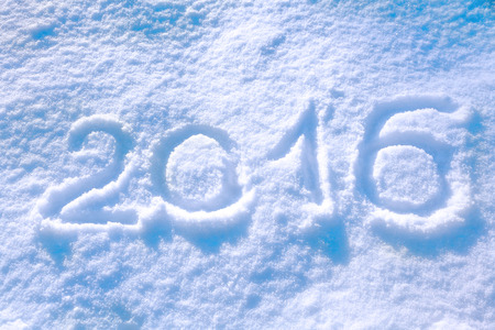 2016 inscription on the snow winter background