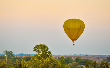 big yellow balloon flying in the sky Stock Photo