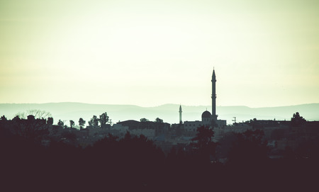 settlements: landscape Arab settlements with mosque in the evening