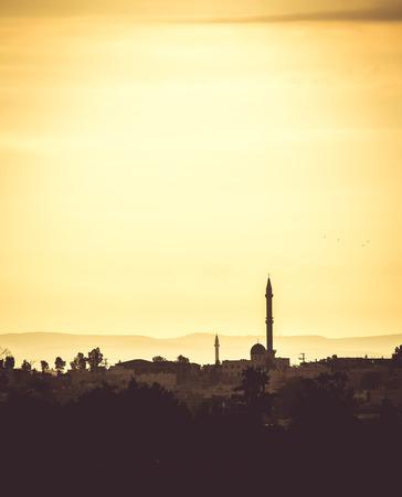 settlements: landscape Arab settlements with mosque at sunset