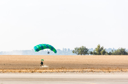 safely: athlete skydiver landed safely on the field