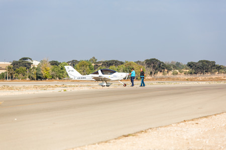 approached: aircraft stands at the airport which was approached by two men