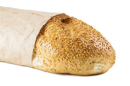 long loaf: long loaf in paper packing isolated on a white background Stock Photo
