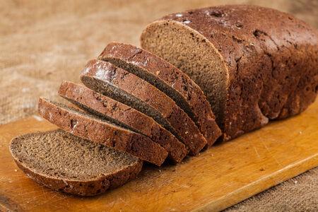 sliced loaf rye bread on a wooden board photo